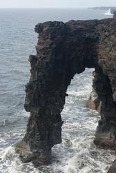 black volcanic rock arch at Holei on the coast of Hawaiis Big Island