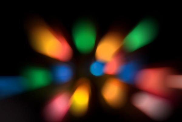 a 'slap zoom' effect abstract background composed of out of focus coloured lights
